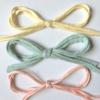 Nouettes jaune pâle, vert tendre, rose corail